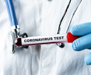 Coronavirus blood test concept. Analyzing blood sample in test t