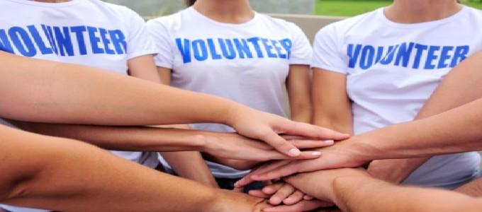 volunteer group hands together